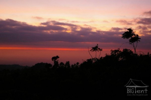 First colors of sunrise in back of mount Merapi