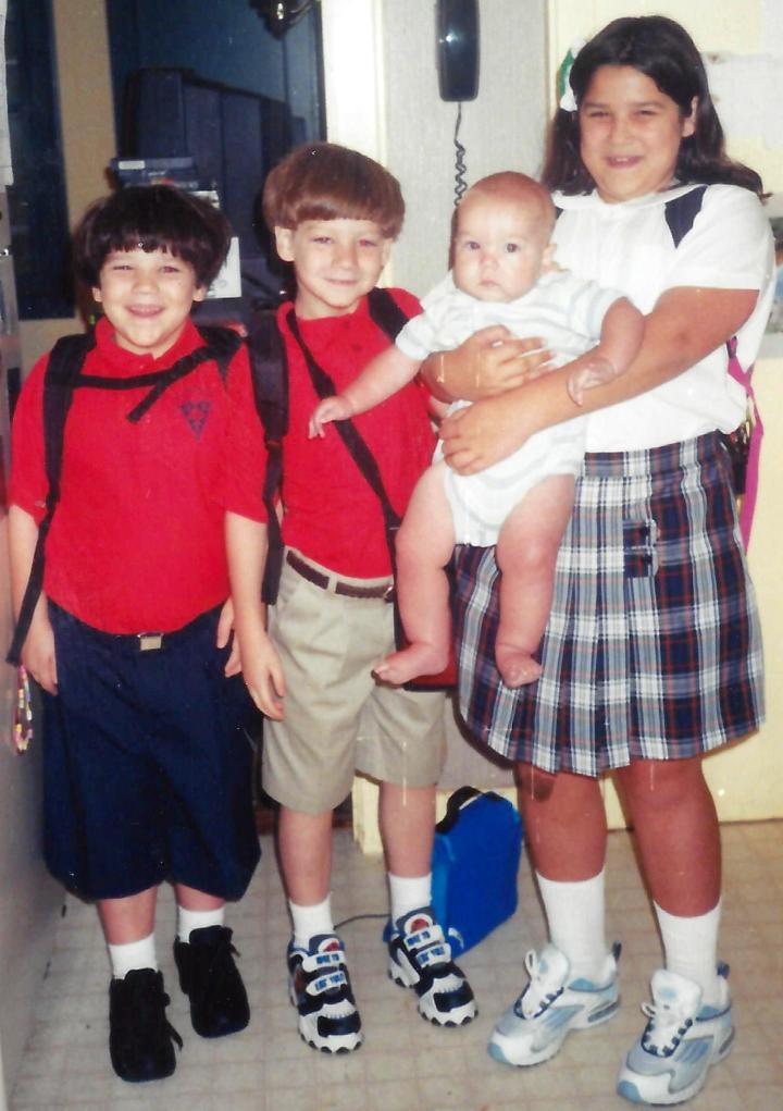 Kids in uniform with baby William