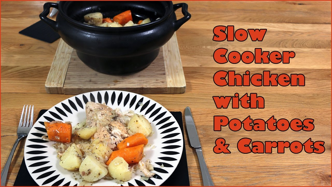 A plate full of slow cooker Mediterranean chicken with potatoes and carrots.