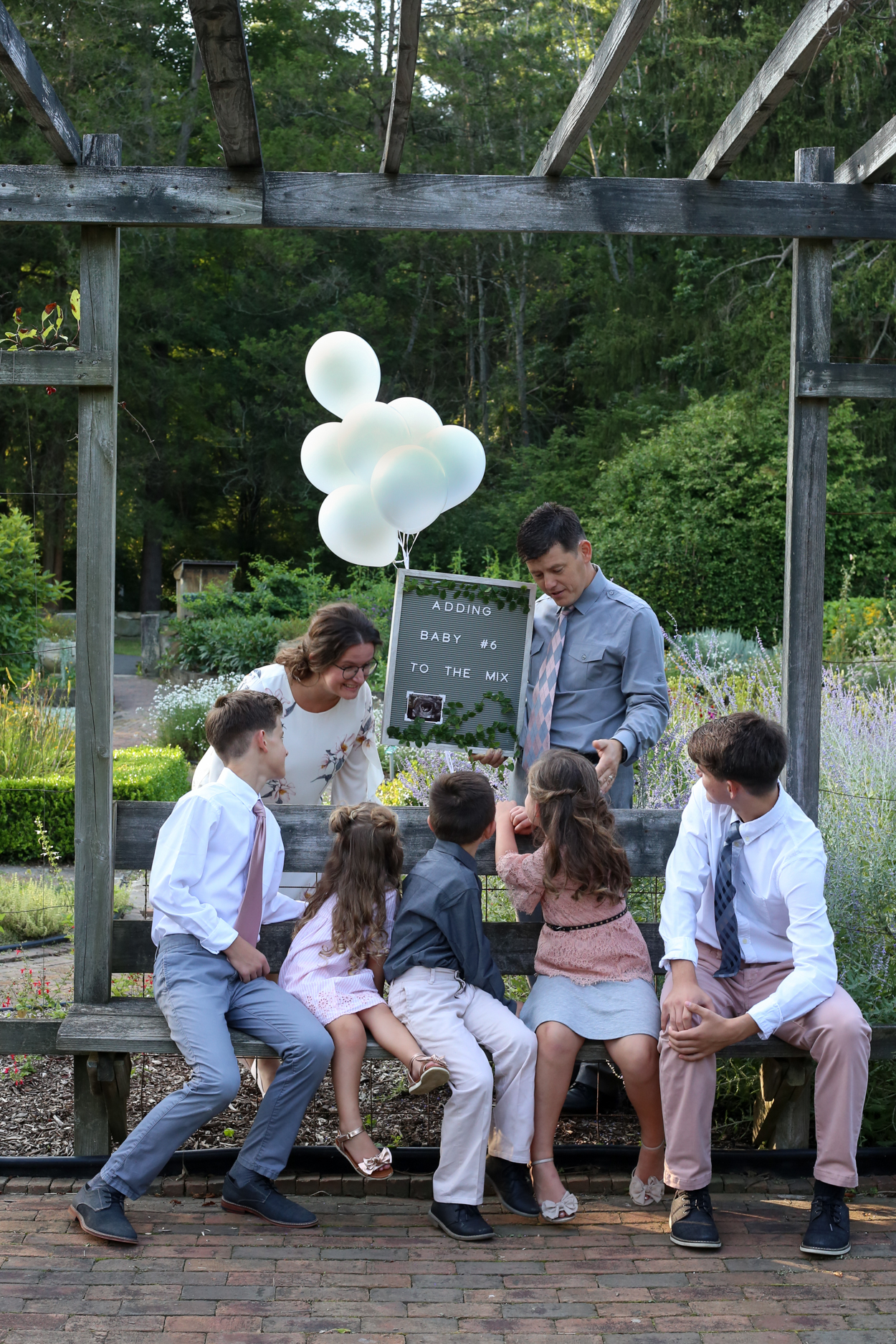 Sharing surprise baby annoucement to siblings.