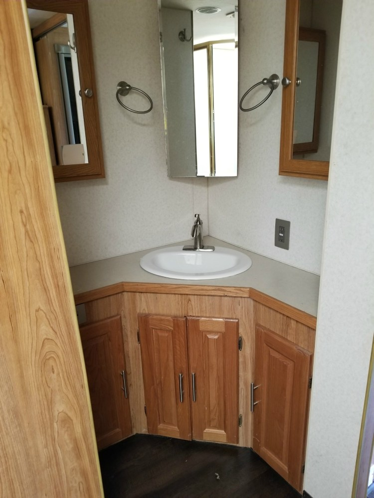 A before picture of the RV bathroom.
