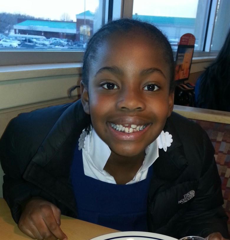 Brown daughter Missing teeth with a huge smile