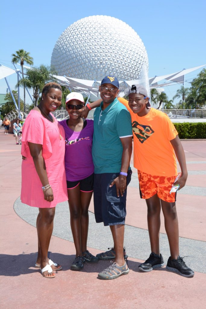 family of color visits walt disney world. Family of color visits epcot.
