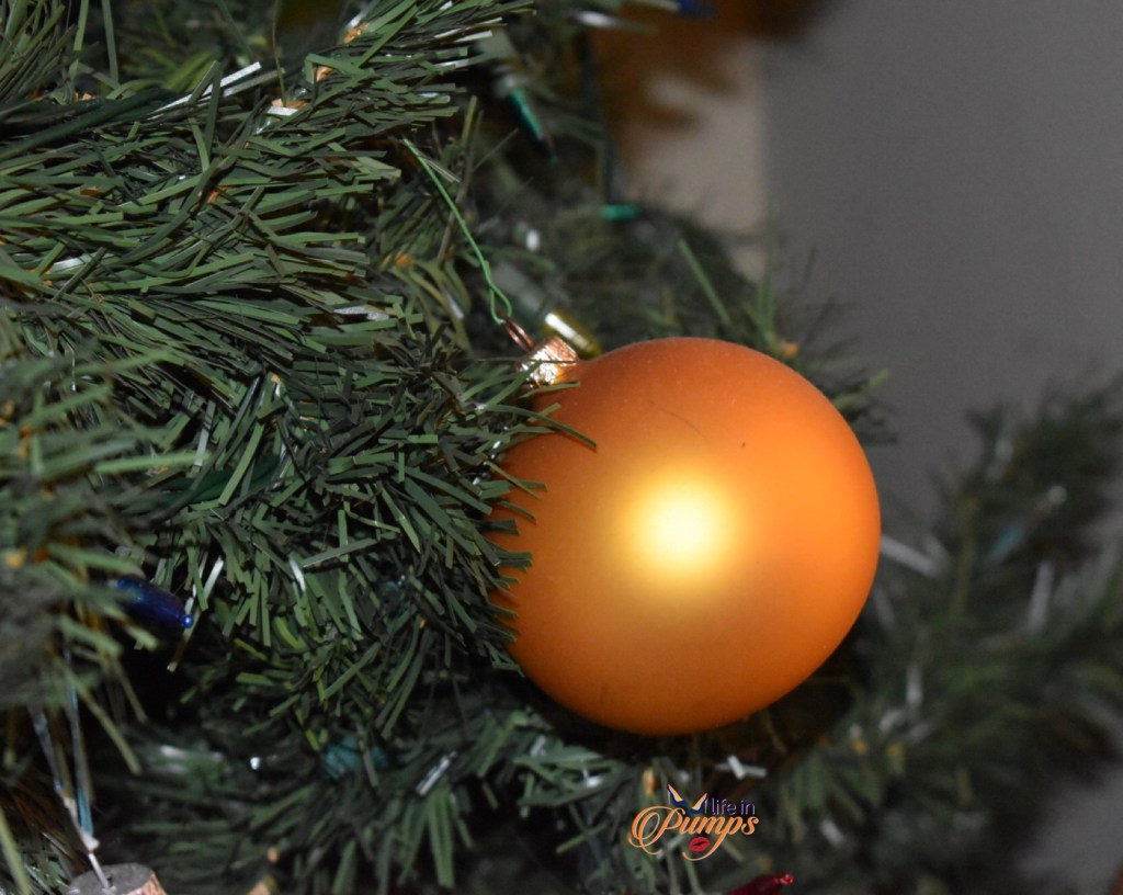 lonely holiday ornament on the christmas tree.