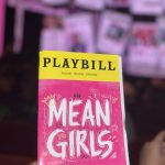 Mean Girls Playbill in Front of Burn Book Set