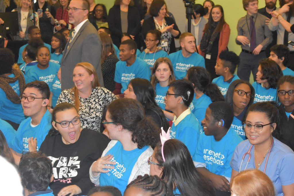 Students at Pennsylvania schools or the death excited about Comcast Internet accessibility announcement and free iPads.