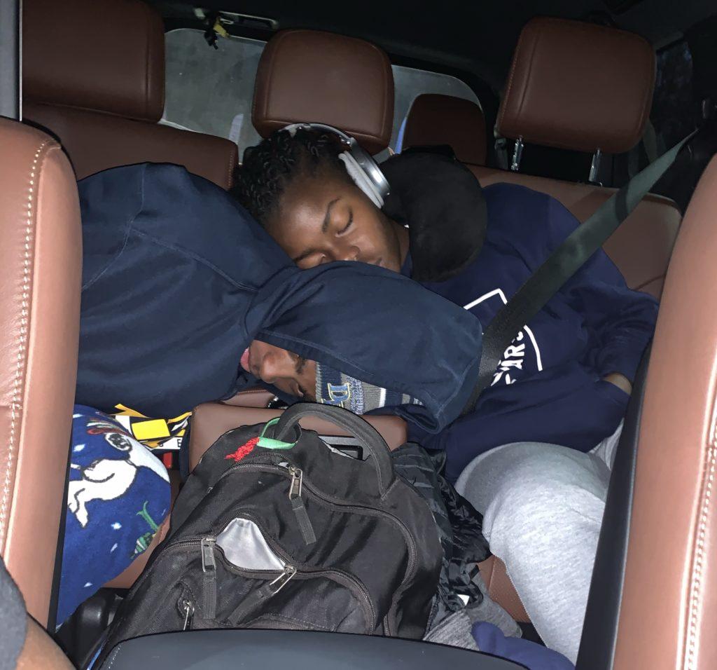 Sleeping Brown Teenagers in the Toyota Land Cruiser