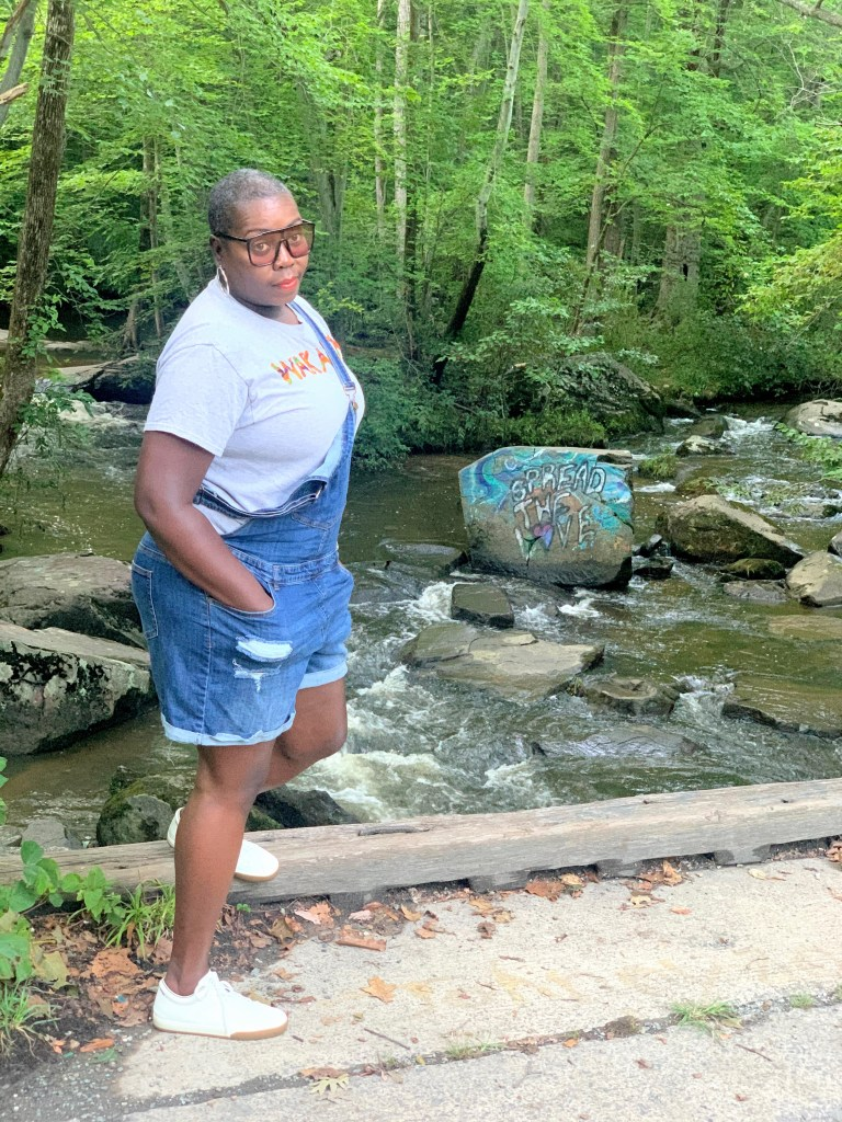 brown girl wearing denim overalls curvy girl fashion fat girl style overweight  overweight bmi hairstyles for over 40 and overweight