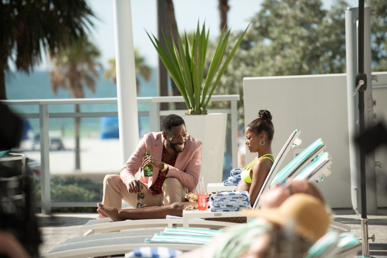 Zola and X at pool with spring breakers