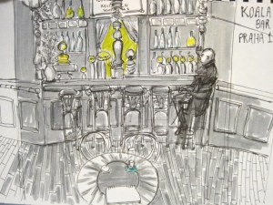 Drawing of man sitting alone in a fancy bar done in greys and pops of yellow. The drawing was done on sight in a bar in Prague, Czech Republic