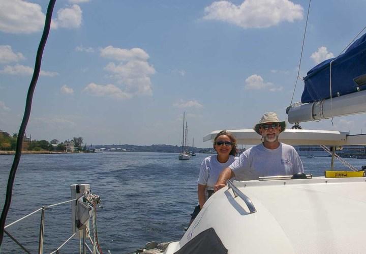 Karen and Dean aboard their boat Snowcat, entering Cuba's Havana Harbor.
