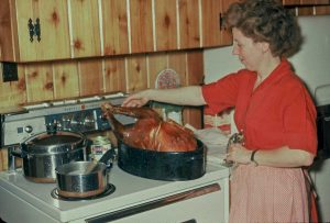 Mom roasting a Thanksgiving turkey