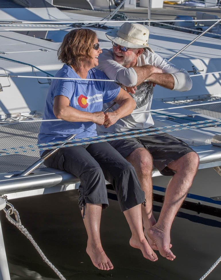 Karen and Dean Massey on the bow of Snowcat
