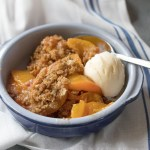 bowl of fresh peach crisp