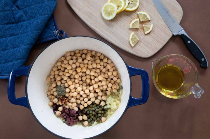 Recipe ingredients - garbanzo beans, kalamata olive, capers, lemon and olive oil