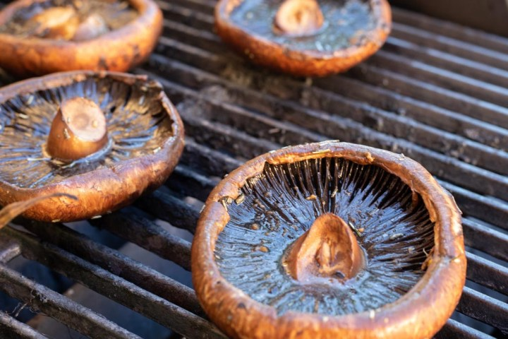 large portabella mushrooms on the grill