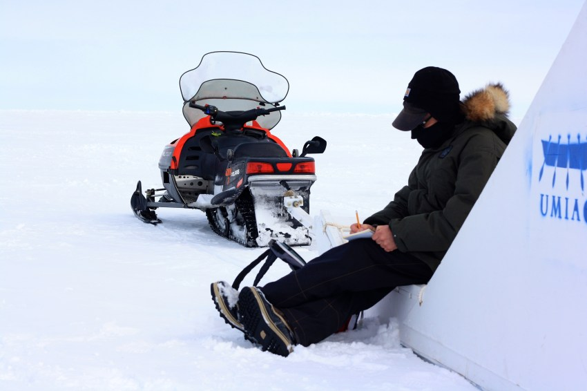 Andy makes notes at our first field site about snow depth and distribution.