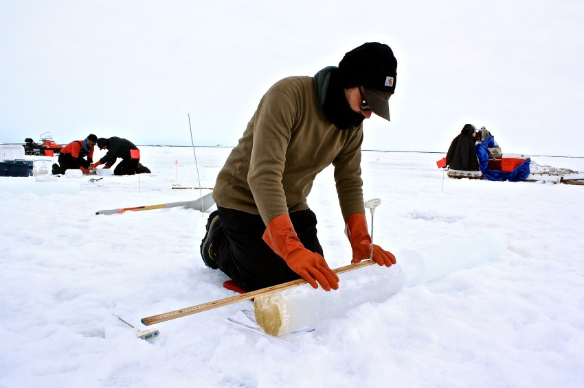 Andy Juhl measures and takes records a temperature profile for each core.