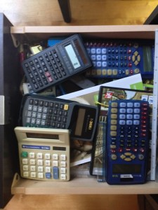 "The drawer of misfit calculators - supposedly I've bought both boys the ""last calculator they will need until they graduate."""