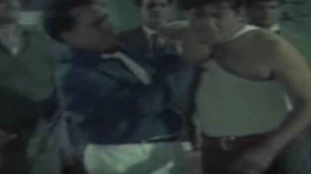 Madan Puri gives Joy Mukherjee a tortuous time.