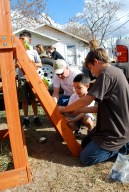 Youth and adults from WordServe build a swingset for a local resident during a Youth-led Compassion Project.