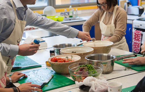Couples making food in a cooking school
