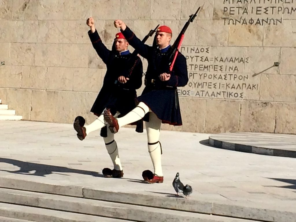 Evzones - 2 of the Presidential Guards in ceremonial uniform with each guard holding a rifle during the changing of the guards