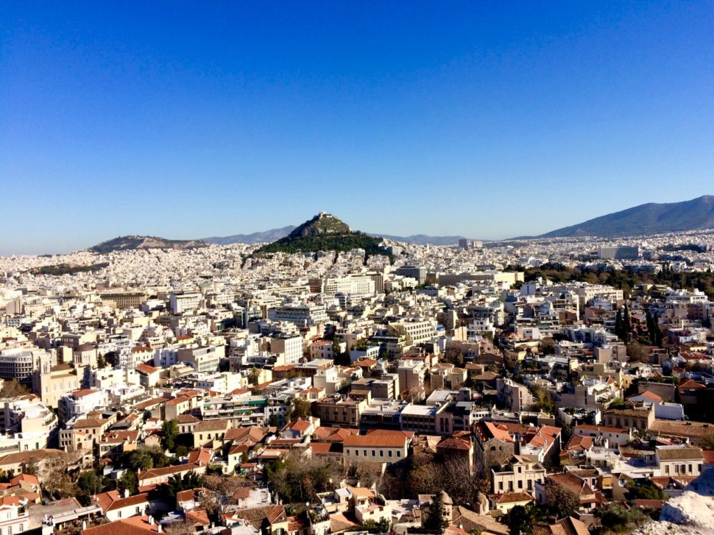 View of Athens city from the Parthenon showing a sprawling city of buildings