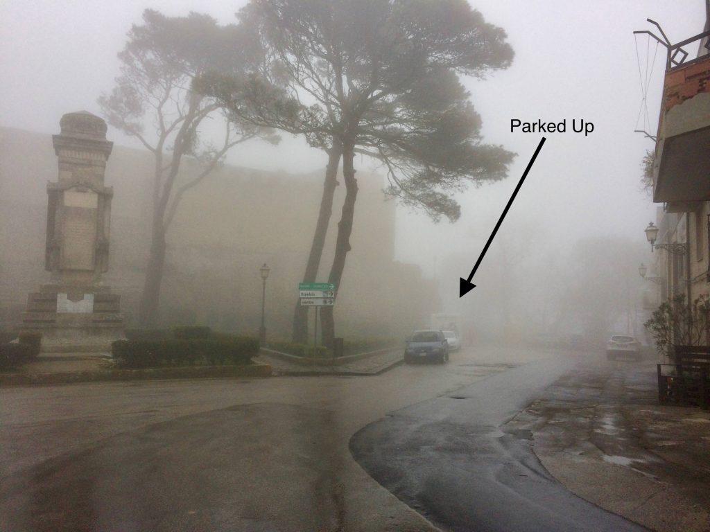 Foggy parking on a street