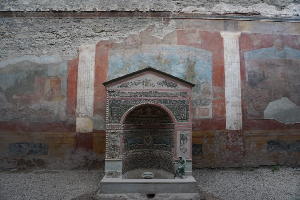 Frescoes with colours of light blue and ochre adorned the internal walls of a home