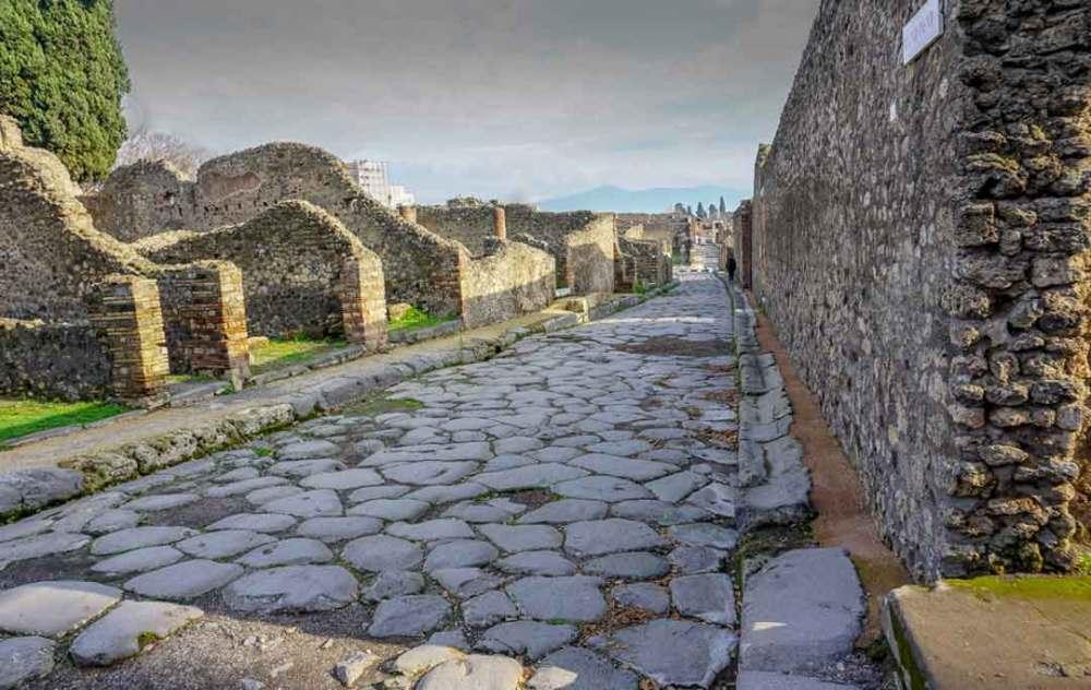 Stone walkways between dilapidated stone buildings