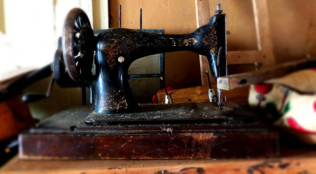 An old antique black and brown sewing machine