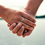 married couple's hands clasped
