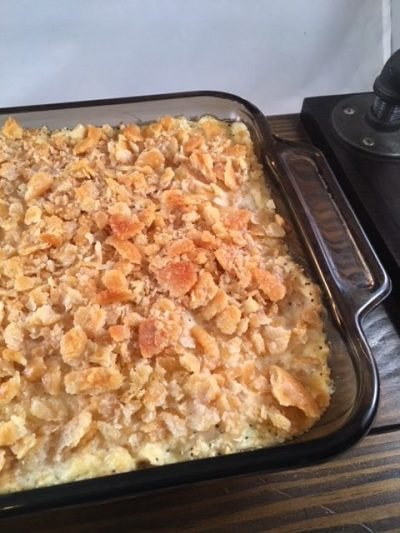 shredded chicken combined with condensed soup mixture, sour cream, poppy seeds, seasonings and crushed crackers in a casserole dish baked till golden brown