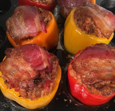 baked stuffed bell peppers with crispy bacon sliced on top of each