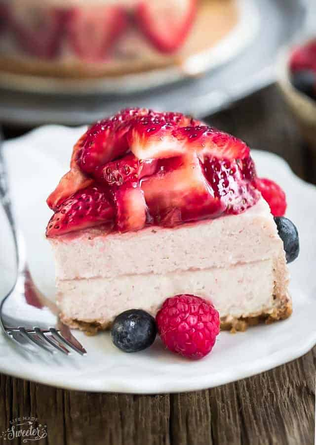 Low Carb Strawberry Cheesecake is rich, creamy and the perfect keto friendly dessert for spring and summer. Made with a gluten free almond flour crust, fresh pureed strawberries and a hint of lemon juice. A delicious no bake treat for Mother's Day, parties, barbecues, picnics and any special holiday.