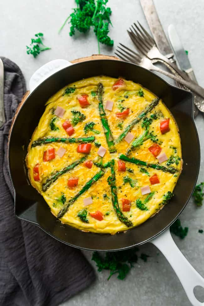 Low Carb Frittata is packed with asparagus, diced ham, bell peppers, cheddar and goat cheese and perfect for a spring breakfast, brunch or dinner. Best of all, this recipe is gluten free and keto friendly.