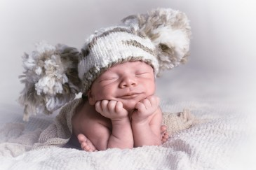 New born baby smiling