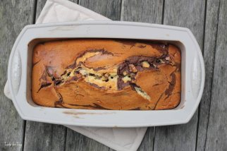 Take 2 spoons and use them to dollop the chocolate and vanilla cake mixes into the tin alternately. Take a skewer and swirl it around the mixture in the tin a few times to create a marbled effect. Bake the cake for 55-60mins until a skewer inserted into the centre comes out clean.