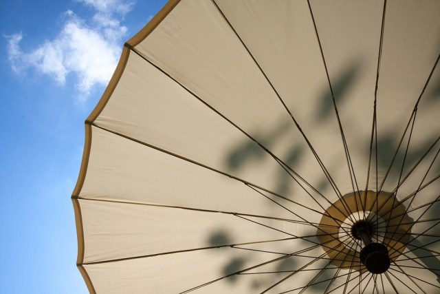 A parasol to provide shade on the patio.