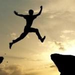 Guy jumping between cliffs