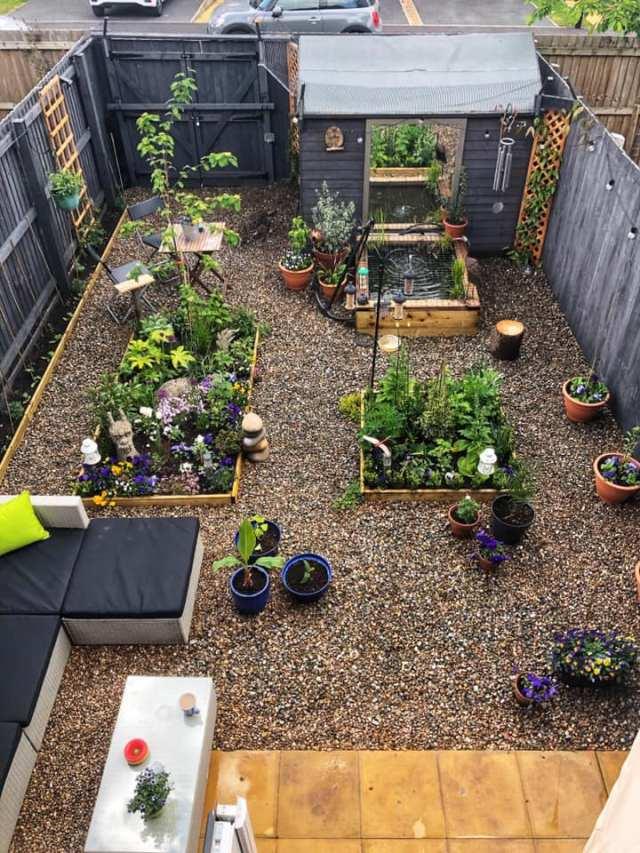 Gravelled garden full of plants and furniture
