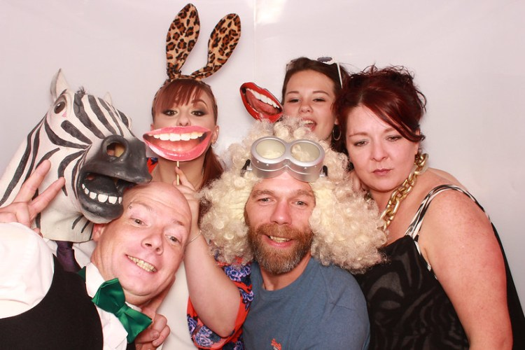 Me and my brother with his daughter and girlfriend in a photobooth