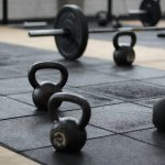 Kettlebells and Barbells scattered around the gym floor