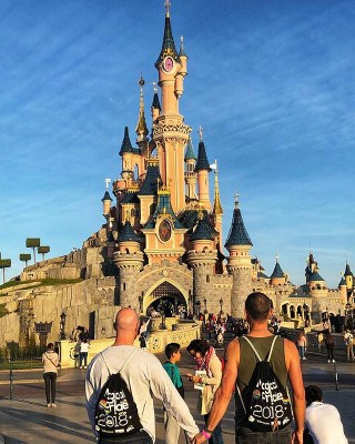 The Husband and I holding hands looking at the Sleeping Beauty castle at Disneyland Paris