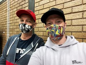 The husby and I wearing face masks while waiting to have out covid jab