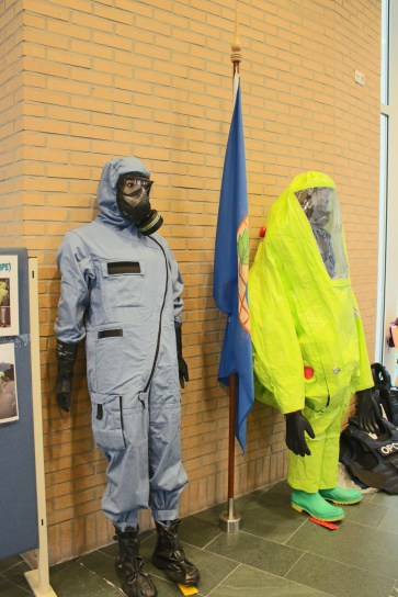 A display of protective suits worn to protect against chemical weapons
