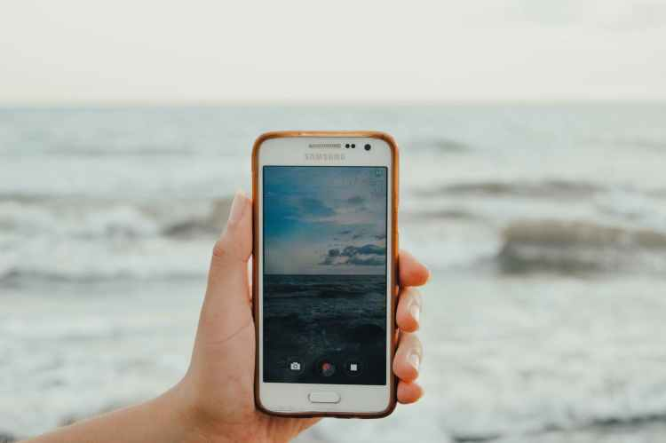 person holding white samsung android smartphone