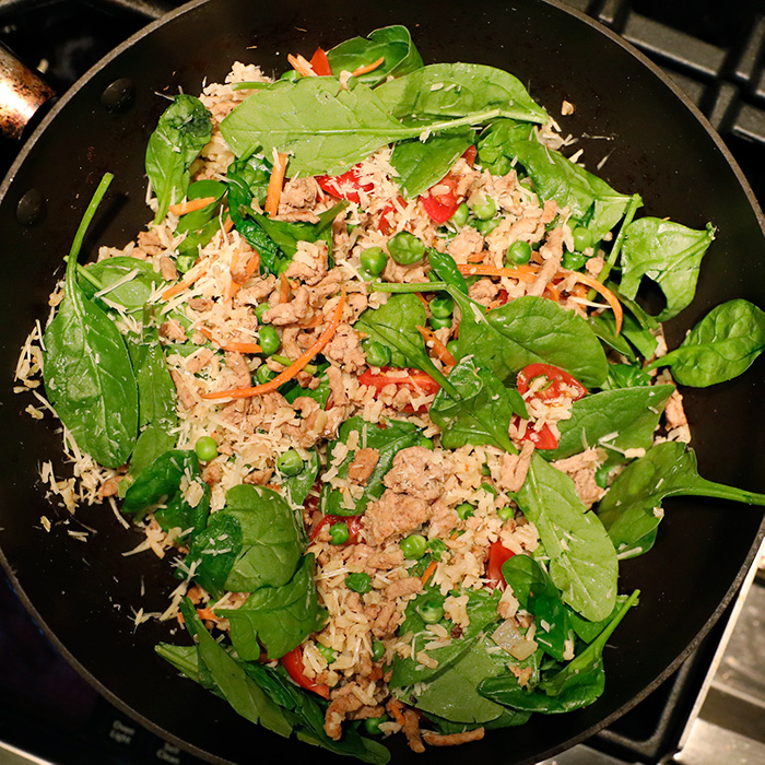 Look at all that goodness that is part of my stuffing for stuffed bell peppers.  Spinach, tomatoes, carrots, turkey, you can't go wrong.