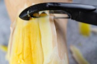 Peeling squash is like peeling a tough carrot.